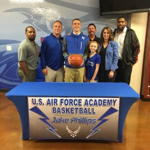 Jake Phillips with family, Coaches Phillips, Biddle, and Bennett, and LCCS A.D. Wade Whites